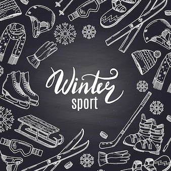 Hand drawn winter sports equipment and attributes on black chalkboard