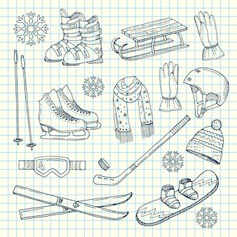 Hand drawn winter sports equipment and attributes on notebook cell sheet