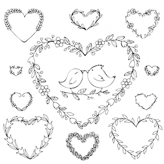 Hand drawn wreath in a heart shape with flowers.