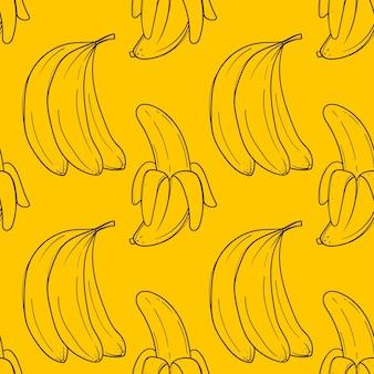 Ручной обращается желтый фон с бананами на белом фоне