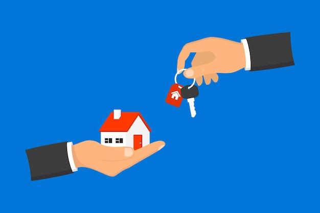 Рука дает ключи от дома клиенту. бизнесмен в костюме, давая ключ от дома. ипотека, кредит или концепция собственности. продажа и аренда квартиры. покупка дома. концепция купли-продажи