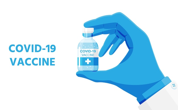 Hand in gloves holds bottle of vaccine. coronavirus covid 19 vaccination concept.