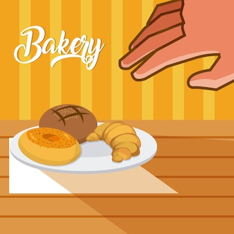 Hand grabbing bakery products on dish
