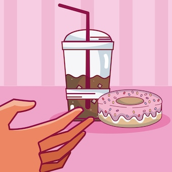 Hand grabbing coffee cold cup with donut