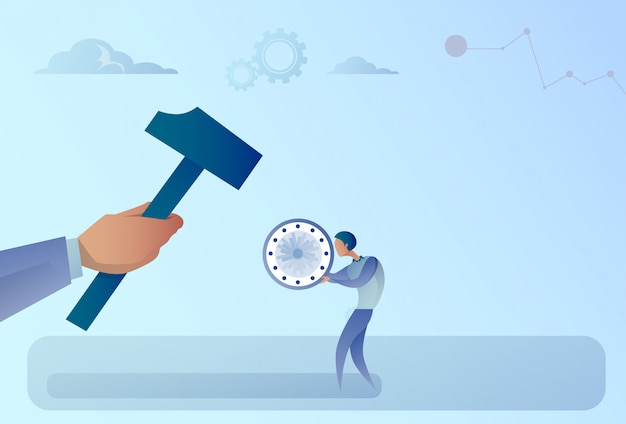 Hand hitting businessman holding clock with hammer