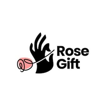 Рука держит розу в подарок цветок логотип шаблон
