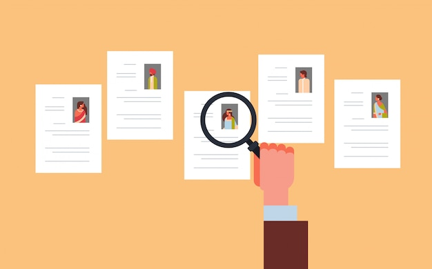 Hand hold magnifying zoom cv resume choosing indian people candidate