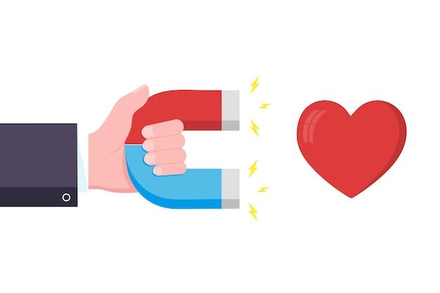 Рука держит красную синюю подкову и магнит привлекает сердце, как знак значка