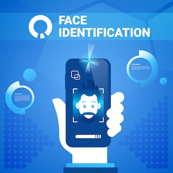 Hand hold smart phone face identification technology scannig man access control system biometrical recognition concept