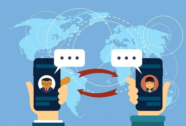 Hand hold smart phonesover world map