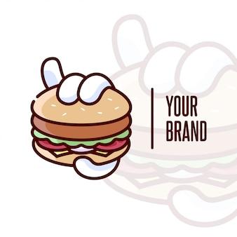 В руке держать большой бургерный мультфильный логотип для кулинарного бизнеса
