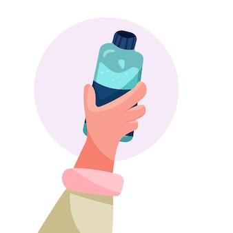 물 한 병을 들고 손