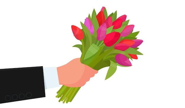 白い背景に花の花束を持っている手。お誕生日おめでとう、国際女性の日。