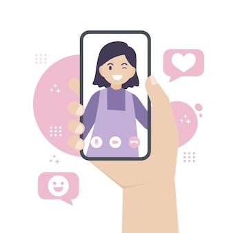 친구 나 사랑하는 사람 또는 다른 사람에게 화상 통화하는 동안 스마트 폰을 손에 들고