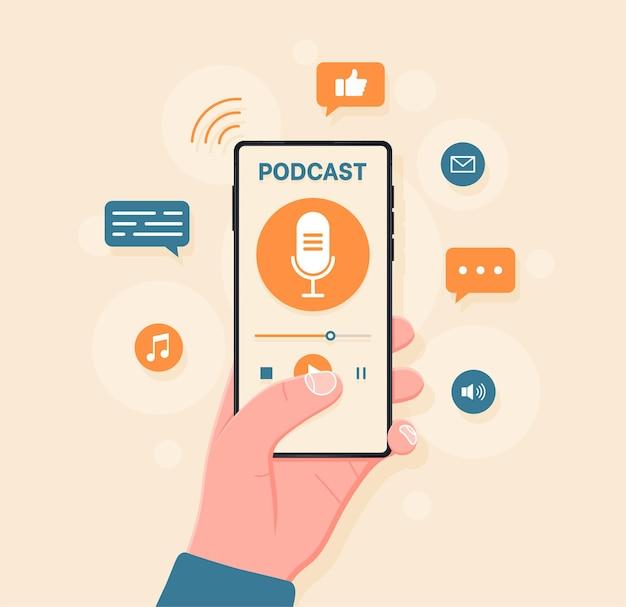 화면에서 팟캐스트를 듣기 위한 응용 프로그램이 있는 스마트폰을 들고 있는 손