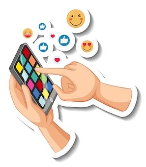 흰색 바탕에 이모티콘 아이콘이 있는 스마트폰을 들고 손