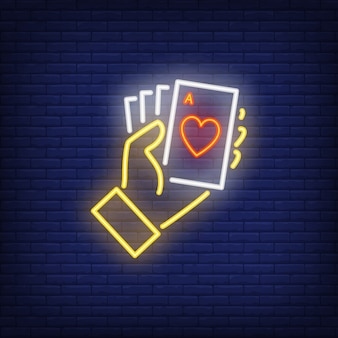 Hand holding ace cards neon sign