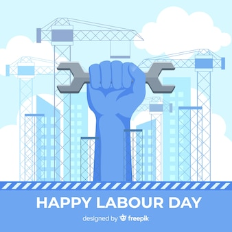 Hand holding adjustable wrench labor day background