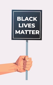 Hand holding black lives matter banner awareness campaign against racial discrimination of dark skin color