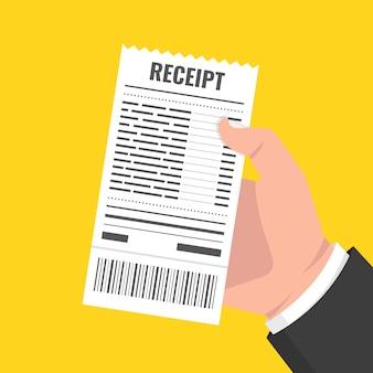 空白の領収書を持っている手。請求書atmテンプレートまたはレストランの紙の財務小切手
