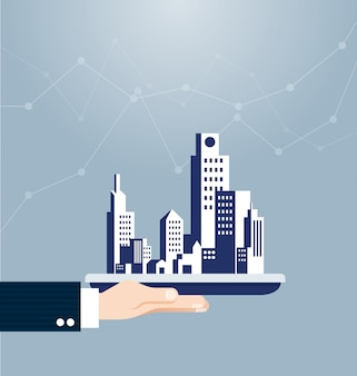 Hand holding building real estate concept