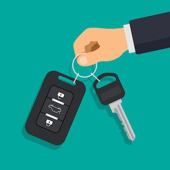 손을 잡고 자동차 키와 경보 시스템. 렌터카 또는 판매 개념입니다.