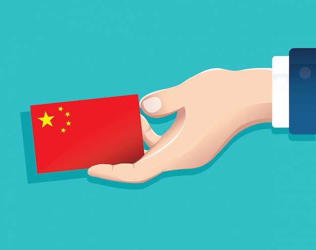 Hand holding china flag card