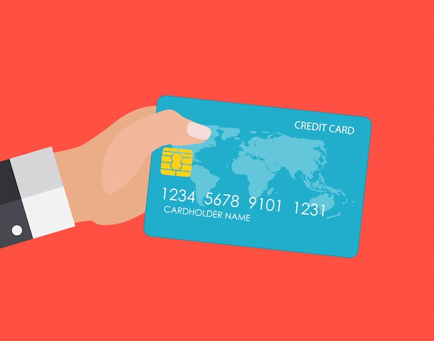 Hand holding credit card. financial and online payments concept