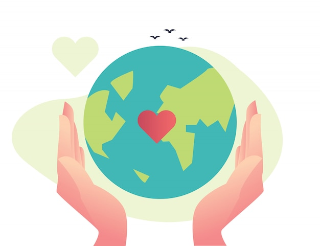 Hand holding earth go green
