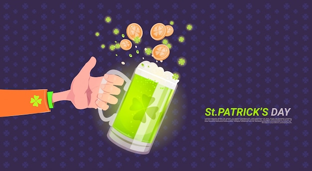Hand holding glass of beer over happy st. patricks day background