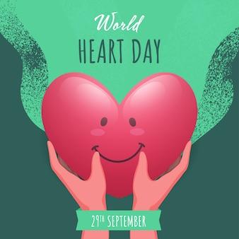 Рука, держащая глянцевое улыбающееся сердце на зеленом фоне шумового эффекта для всемирного дня сердца,