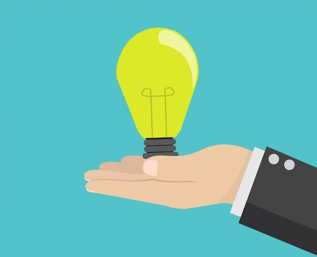 Hand holding idea light bulb