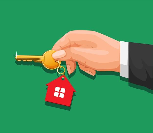 Hand holding key house in cartoon illustration