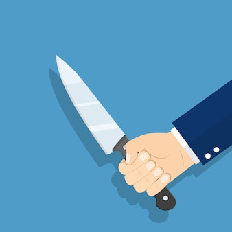 Рука, держащая нож