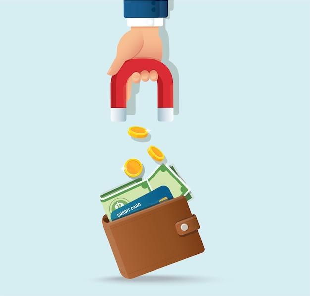 지갑에서 돈을 유치하는 자석을 들고 손