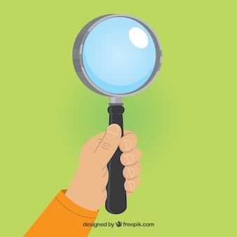 Hand holding magnifying glass background in flat style