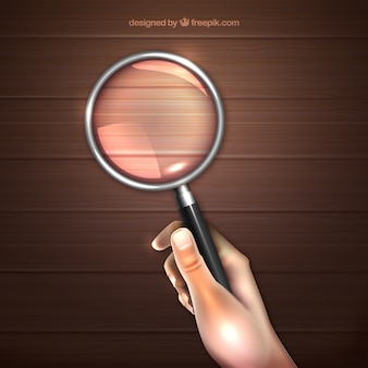 Hand holding magnifying glass background in realistic style