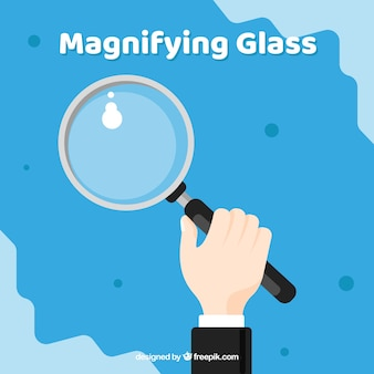 Hand holding magnifying glass in flat style