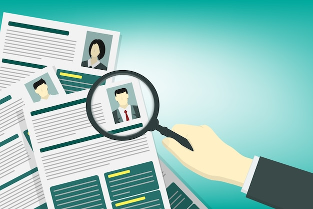 A hand holding magnifying glass on resume