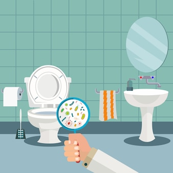 Hand holding a magnifying glass showing bacteria in the toilet, wc, hygiene in the bathroom