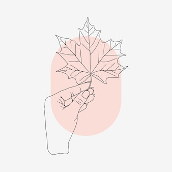 Рука, держащая кленовый лист в стиле арт линии 1