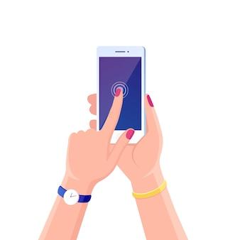 白い背景の上の携帯電話を持っている手。デジタル機器