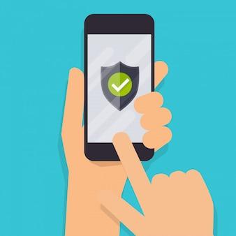 画面に緑の盾を持つモバイルスマートフォンを持っている手。オンラインサービスのコンセプトです。フラットの図。