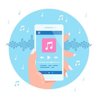 손을 잡고 오디오 또는 라디오를 재생하는 현대 전화. 스마트 폰 음악 플레이어 사용자 인터페이스 개념. 미디어 플레이어 앱