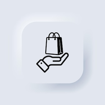Hand holding paper bag. shopping bag icon. click and collect order online. vector. purchase business concept. neumorphic ui ux white user interface web button. neumorphism. vector