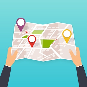 Hand holding a paper map with points. tourist look at map of the city.  illustration in  . travel concept.