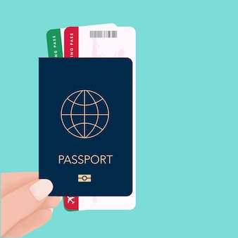 Hand holding passport and boarding pass ticket