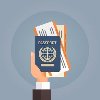 Hand holding passport ticket boarding pass