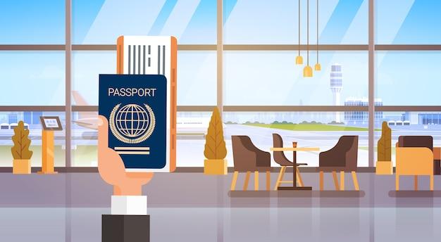 Hand holding passport ticket