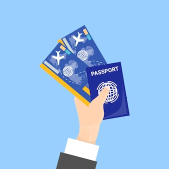 Hand holding passport and tickets isolated